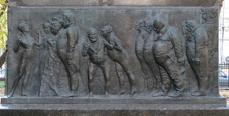 Барельеф, обрамляющий пьедестал памятника Гоголю на Никитском бульваре.